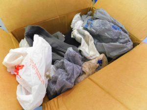 cardboard-box-full-of-shirts-and-socks
