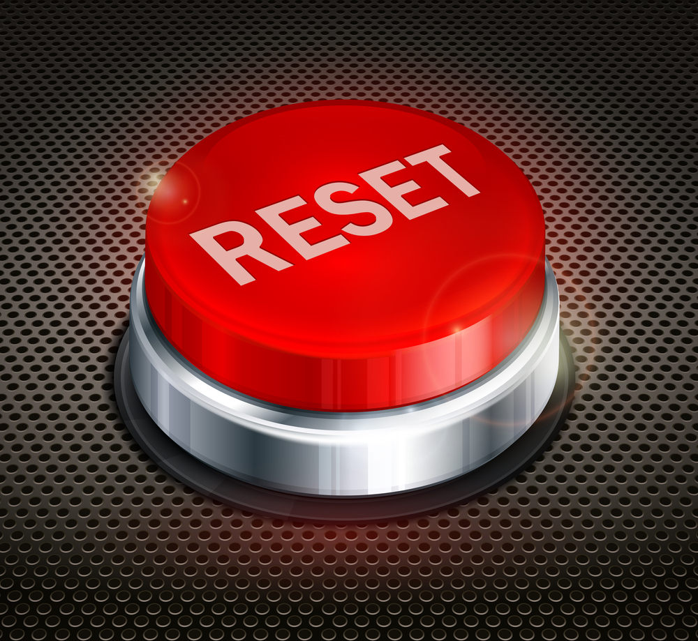 big-red-reset-button-on-metal-background